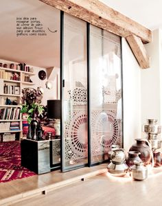 Lovely glass sliding doors with a moroccan pattern etched in. A great way to mix sleek modern with ethnic!  The Paris apartment of Stephanie de Saint Simon, owner of Ouma Productions.