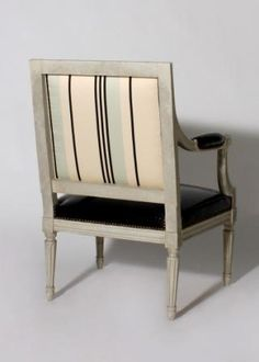 vintage French fauteuils reupholstered with stripes & patent leather by Jan Showers