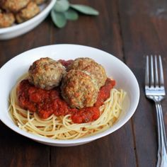 Oven baked turkey sage meatballs served over spaghetti, makes for an easy, hearty pre-trick or treating meal.