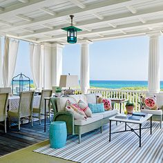 Seaside Classic - Blending historical architectural forms w/ modern comforts, architect Robert A. M. Stern designs an Alabama family's dream house, giving special attention to spacious porches. For this home, architectural classicism was reinterpreted for the coast w/light & airy interiors. 3 levels of porches, including one for living & dining on  2nd level, allow for big ocean views --Wooden coffer ceilings