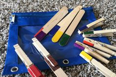 10 Toddler Busy Bags For Traveling- Popsicle sticks and clothes pin color match