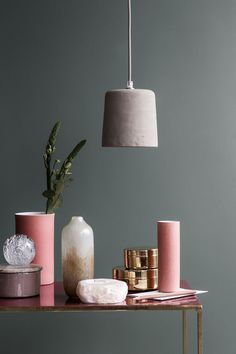 pink, purple, and copper details on a dark background for a design table
