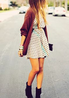 Polka dot dress with a long maroon cardigan.