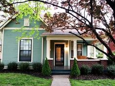 Inspiration: red brick Craftsman home with teal exterior