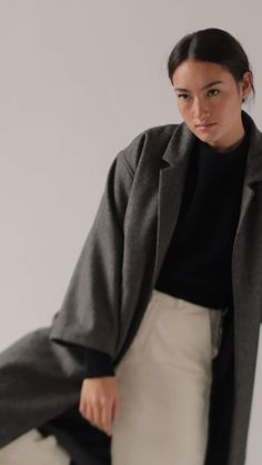 Crafted from certified organic wool, this coat has a relaxed fit with dropped shoulders, two side pockets and a lapel collar. Wear it over a chunky knit or a (recycled) down jacket for extra warmth when the temperature drops. A contemporary essential. Wool Overcoat, Winter Coat, Capsule Wardrobe, Dapper, Dark Grey, Poland, Knitwear, Label, Normcore