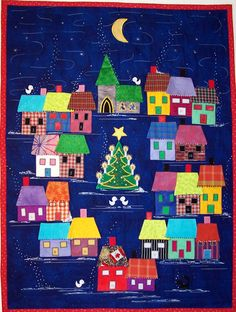 Advent Calendar Village Pattern by Lisa Girard Tivoli Quilt Creations . Each house is a pocket and the roof is a flap