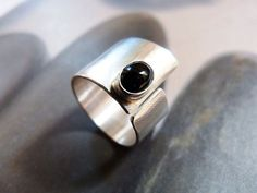 Minimalist Sterling silver ring with onyx cabochon. A tiny oval onyx cabochon has been set in Sterling silver bezel setting. The base of the ring was