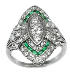STUNNING edwardian ring with emeralds.