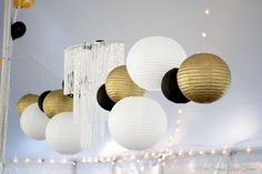 Transform the tent for your rustic chic wedding with classic black, white and gold themed accents.
