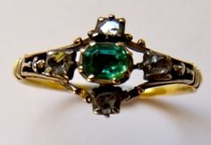 Emerald and diamond eighteenth century ring. Emerald and diamond cruciform shaped ring set in silver and gold, the central emerald surrounded by four rose cut diamonds.  circa 1720-40