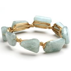 What a beautiful bracelet design - 14k gold filled wire wrapped around faceted aquamarine stones.