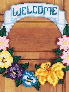 """Spring Floral Door Wreath Plastic Canvas Pattern Download from e-PatternsCentral.com -- Welcome friends with this 13"""" x 12"""" floral wreath."""