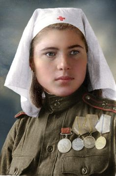"""Color by Klimbim Female lieutenant in Medical Services of the Soviet army, 1944-45. Medal for Courage, two Medals for Battle Merit, Medal """"For the Defence of the Caucasus""""."""