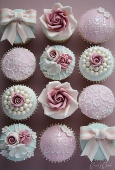 Pink and ivory decor cupcakes, ribbons pearls and rose.
