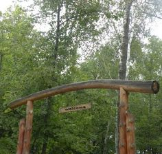 driveway arch - gotta have one of these too, except made out of barn wood and a little more rustic
