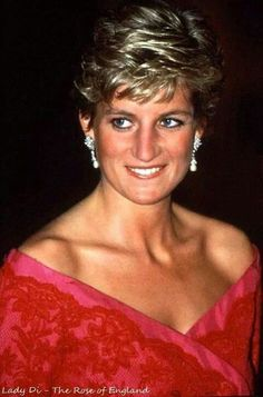 1990: Princess Diana at the Barbican, London, England. Diana in a red off-the-shoulder dress worn many times, including Japan 90 (w/pearl drop earrings), and Brazil 91 (w/pearl drop earrings), and Royal College of Music London 91 (w/pearl necklace), Barbican 90 (w/pearl drop earrings).
