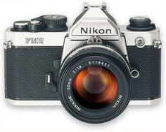 Nikon FM-2: My first camera. A sad, sad day when it was lost in the ocean in Mexico.