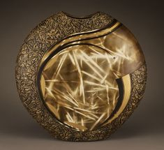 Christine Colombarini. clay primitive straw-fired and hand colored using oils, acrylics, textured modeling paste, and gold leaf.