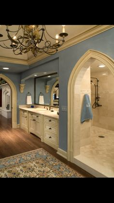The blue paint and rug are gorgeous in this elaborate bathroom