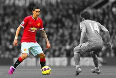 Don Kuing - Angel di Maria of Manchester United is closed down by Jordi Gome