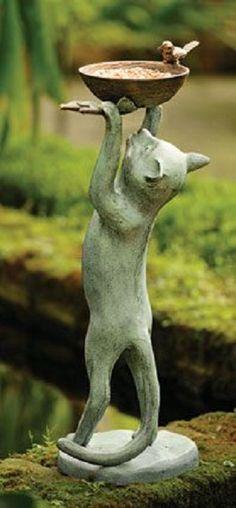 Cat statue holding a bird feeder ... a cat's dream!