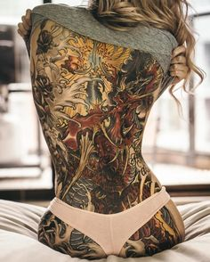 Awesome dragon back full tattoo for girl