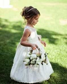 All three flower girls at this wedding in Wine Country carried baskets of garden roses and jasmine vine