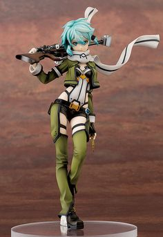 Sword Art Online II - Sinon 1/7th Scale: From the anime series 'Sword Art Online II' comes a figure of the Phantom Bullet Arc's heroine, Sinon! The figure is sculpted by Satoshi Toda, known to give his works a heavy and realistic sculpt. Sinon is posed with her scarf blowing in the wind, as she marches along the battlefield with her favorite sniper rifle in hand. The 'Ultima Ratio Hecate II' as well as the two Glock 18Cs have been digitally modeled with careful precision, and Sinon herself…