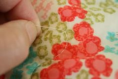 Due to several requests, I decided to write up a little tutorial on how to bury your knots when machine quilting. I've only been doing this ...