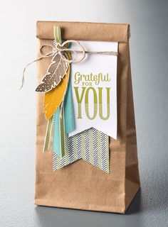 Brown Kraft paper bag gift wrapping finished with pretty tags and die cuts tied with jute twine. #giftwrapping #diy | Run Wild Horses
