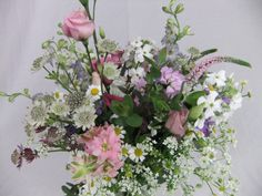 May time bouquet of astrantia, feverfew, larkspur, queen anne's lace and sweet rocket