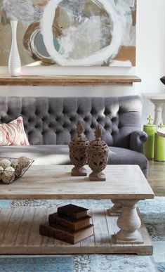 Gorgeous rustic and tactile coffee table & gray tufted couch