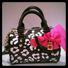 "Betsey Johnson naked cheetah mini barrel crossover Betsey Johnson mini barrel bag with black and white cheetah design. Pink ribbon on front with BJ love heart key chain. Gold zippers. Crossover chain is detachable. Normal handles also give you options. Size: L:7"" H:6""D:4"". Signature BJ maroon lining with pink lips. Gorgeous. A bag to get noticed. Betsey Johnson Bags Mini Bags"