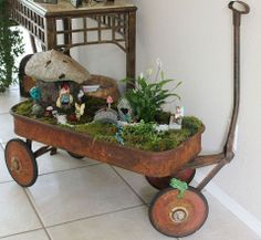 Vintage red wagon gnome garden! Too cool, right? Would love this in a Smurf village!