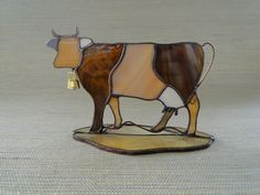Stained glass cow www. Stained Glass Ornaments, Stained Glass Christmas, Stained Glass Suncatchers, Stained Glass Crafts, Faux Stained Glass, Stained Glass Designs, Stained Glass Panels, Stained Glass Patterns, Mosaic Pots