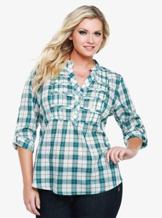 Trend-focused military details - frogging on the front, a Mandarin collar and button-tabbed sleeves - edge up this blue plaid top. For a flattering fit, we've given the top an empire waist.