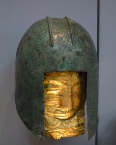 Greek bronze helmet of Illyrian type with gold death mask, Sindos Tomb 115, ca. 520 B.C.E. Archaeological Museum of Thessaloniki Photo by Dan Diffendale