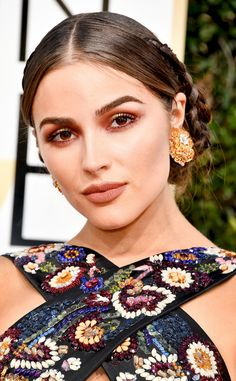 Olivia Culpo from 2017 Golden Globes' Best Beauty Looks  The model's painted face was deep and moody—in the best possible way.