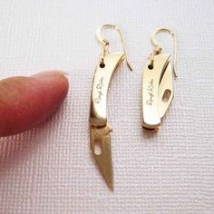 Tiny Pocket Knife Earrings, $39  Takes a whole new meaning to let me take my earrings off!  Reminds me of the bullet earrings @Jordan Rolph