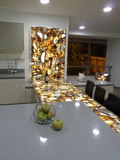 This 8310 Concetto Brown Agate with the back lighting makes for great entertaining at night. www.caesarstone.ca