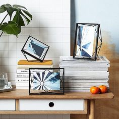 Geometric frames that will delight any design lover.   Photo by @johnlewisretail    Umbra PRISMA Frame Black design by Sung Wook Park #prisma