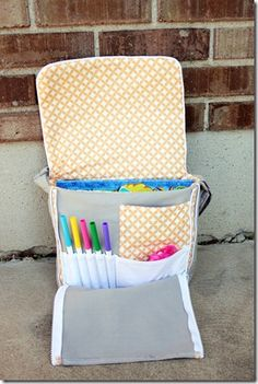 toddler size messenger bag complete with all kinds of pockets - this would be great for traveling!