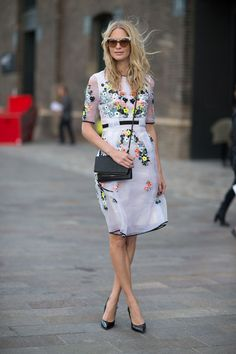 POPPY DELEVINGNE This windswept model is the picture of pretty in neon florals by Erdem.