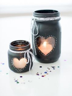 These chalkboard-paint candles can be made with mason jars, baby food jars, or any other jars you have in your house. Get the how-to via @Alexandra Heart Love Weddings >>