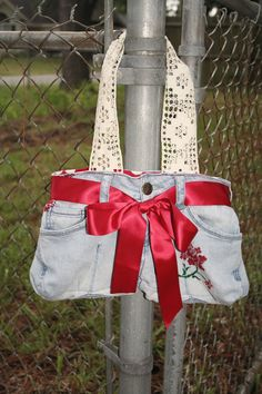 Repurposed Polka Dot Peace Jeans and Crocheted Handle Purse with Pleats and Ribbon 13x15. $23.00, via Etsy.