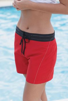 Women Swimming shorts com one with modest one piece or swim shirt.