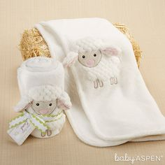 """Like a cozy white cloud, this little lamb blanket keeps baby warm with a tender touch. 