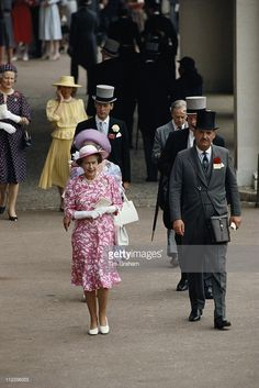 Queen Elizabeth II and her equerry, Major Hugh Lindsay (1954-1988), at the Royal Ascot meeting, at Ascot racecourse, in Ascot, Berkshire, England, Great Britain, 19 June 1984. Walking just behind the Queen is the Queen Mother (1900-2002).