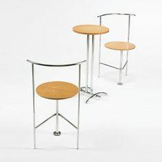 SHIRO KURAMATA    pair of Three-legged B chairs and table    Ishimaru Co., Ltd.  Japan, 1986  chrome-plated steel, ash  15 dia x 30 h inches  Chairs measure: 18.25 dia x 30.25 h inches