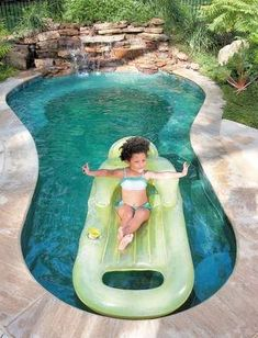 """Lucie Jane Black, 4, floats in the spool — a combination in-ground small pool and spa — in the backyard of her grandparent's home. Don and Lucie Black had the spool installed about two years ago. """"I wouldn't want it any bigger or any smaller,"""" Don Black says. """"(It) has given us a whole new place to entertain."""""""